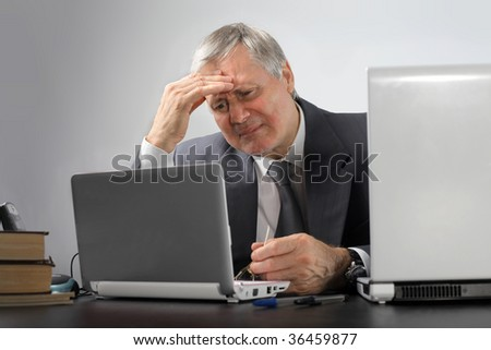 thoughtful senior business man using laptop - stock photo