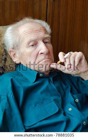 thoughtful senior man holding electronic cigarette - stock photo