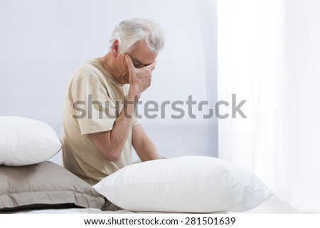 thoughtful senior man looking down (man, sad, depression) - stock photo
