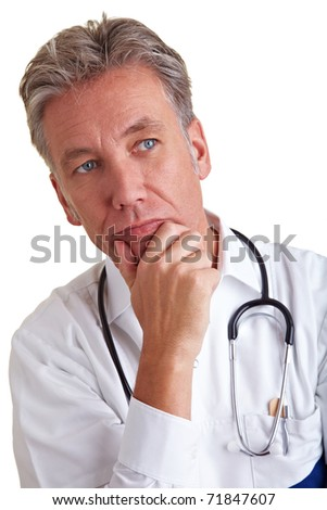 Thoughtful senior physician thinking with hand on his chin - stock photo