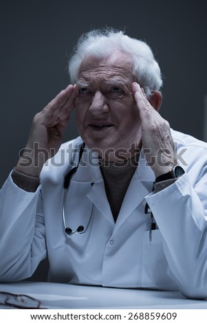 Thoughtful senior practitioner having problems at work - stock photo