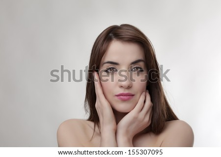 Thoughtful sexy brunette model looking at camera - stock photo