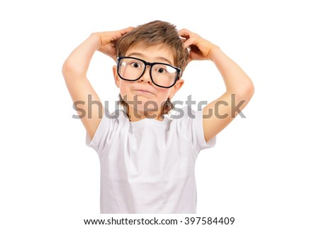 Thoughtful smart boy wearing big glasses. Education. Optics. Studio shot. Isolated over white. - stock photo