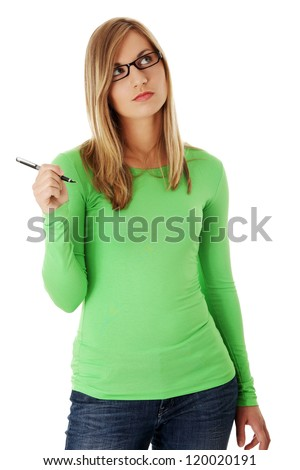 Thoughtful student girl with pen, isolated on white - stock photo