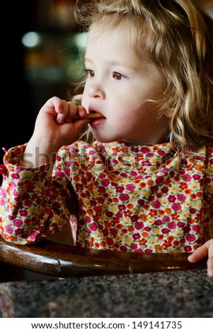 thoughtful toddler girl in cafe
