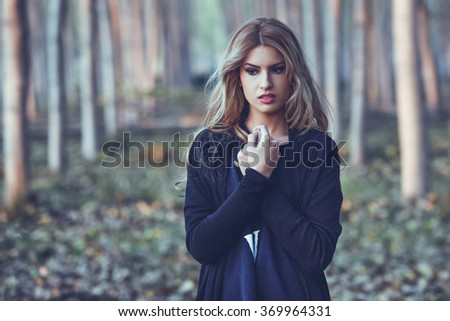 Thoughtful woman alone in a poplar forest. Girl worried outdoors - stock photo