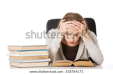 Thoughtful woman learning to exam. - stock photo