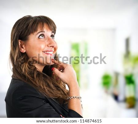 Thoughtful woman portrait - stock photo
