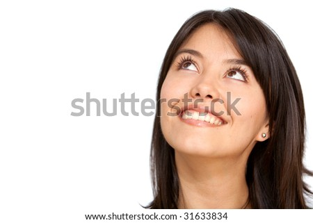 thoughtful woman smiling isolated over a white background - stock photo