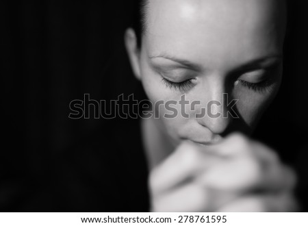 Thoughtful woman with eyes closed.  - stock photo
