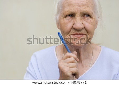 Thoughtful woman with pen - stock photo