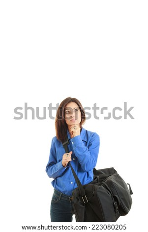 Thoughtful woman with travel bag going on business trip imagining - stock photo