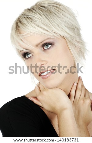 Thoughtful young blond woman looking upwards with a serene expression isolated on white