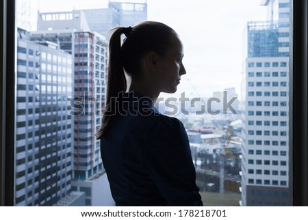 Thoughtful young business woman - stock photo
