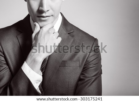 Thoughtful young businessman - stock photo