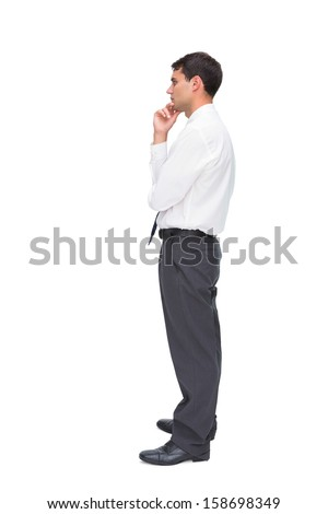 Thoughtful young businessman looking away on white background - stock photo