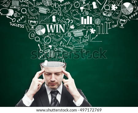 Thoughtful young businessman with business sketch coming out of his head on chalkboard background. Brainstorming concept