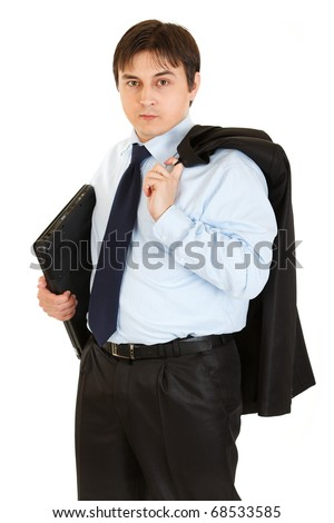 Thoughtful young businessman with jacket on his shoulder holding folder in  hand isolated on white