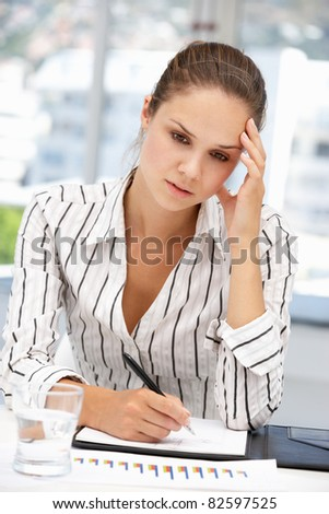 Thoughtful young businesswoman