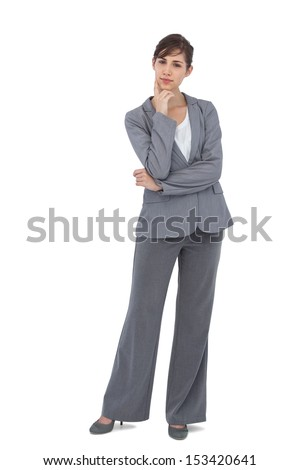 Thoughtful young businesswoman looking at camera on white background  - stock photo