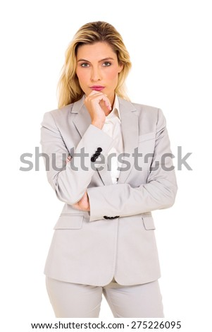 thoughtful young businesswoman looking at the camera - stock photo