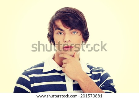 Thoughtful young handsome man portrait - stock photo