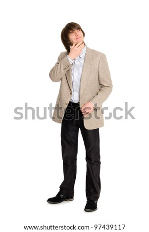 Thoughtful young man looking up. - stock photo