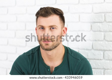 Thoughtful young man portrait - stock photo