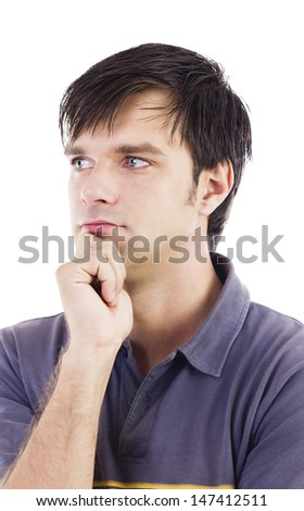 Thoughtful young man portrait, right hand holding the chin, looking to the right, close up, isolated on white, studio shoot.