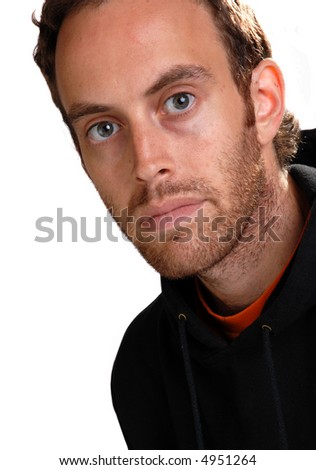 Thoughtful young man with rivetting gaze - moody close-up - stock photo