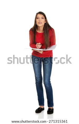 Thoughtful young student woman with her note. - stock photo