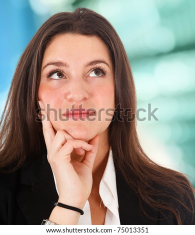 Thoughtful young woman - stock photo
