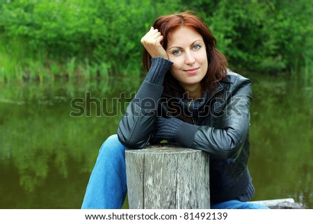 Thoughtful young woman outdoors