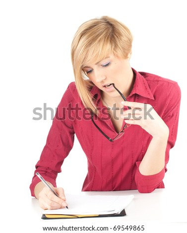 thoughtful young woman with eyeglasses writing on black clipboard