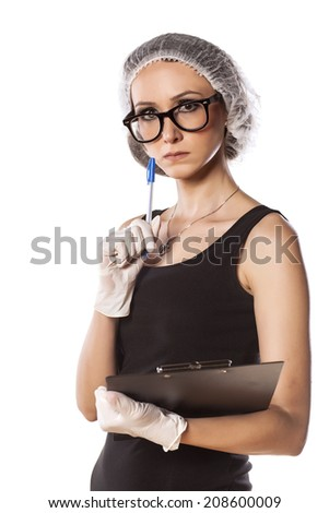 thoughtful young woman with pen, protective cap and gloves - stock photo