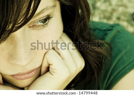 Thoughtful young woman with pensive gesture. - stock photo