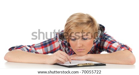 thoughtful young woman writing on black clipboard