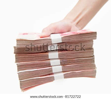 Thousands china's currency one hundred RMB yuan in hand isolated on white - stock photo