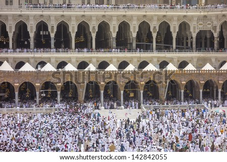 Thousands of Muslims dispersed after Friday prayer at Masjidil Haram mosque in Makkah, Saudi Arabia. - stock photo