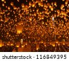 Thousands of sky lanterns, flying lanterns, floating lanterns, hot-air balloons , Loy Krathong (Yi Peng) Festival in Chiang Mai Thailand - stock photo