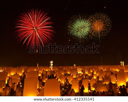 Thousands of sky lanterns with fireworks, flying lanterns, floating lanterns, hot-air balloons , Loy Krathong (Yi Peng) Festival in Chiang Mai Thailand - stock photo