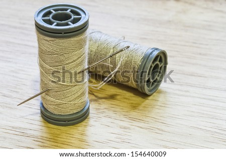 Thread and needle for sewing - stock photo