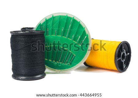thread and sewing needle on white background