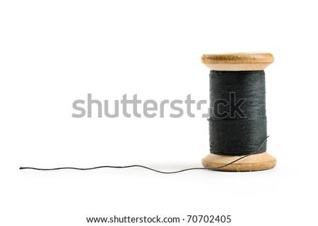 Thread bobbin isolated on white background - stock photo
