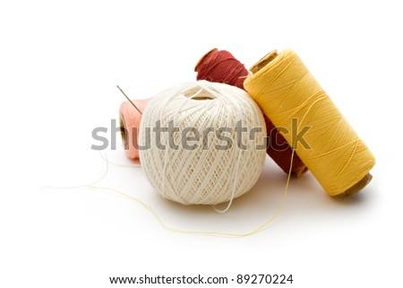 Thread bobbins on the white background - stock photo