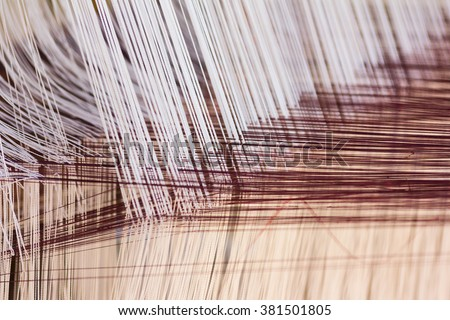 Thread from weaving machine, Abstract background - selective focus. - stock photo