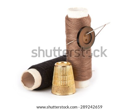 thread, needle, button and thimble on isolate white background - stock photo