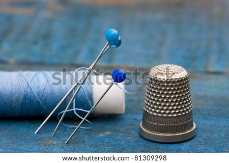 thread, needles and thimble - stock photo