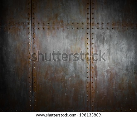 threadbare rusty  steel covering with rivet,  iron background - stock photo