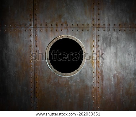 threadbare rusty steel side submarine or ship with airport ( illuminator). - stock photo